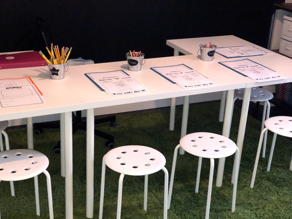 Close-up of a table with various speech activities on it.