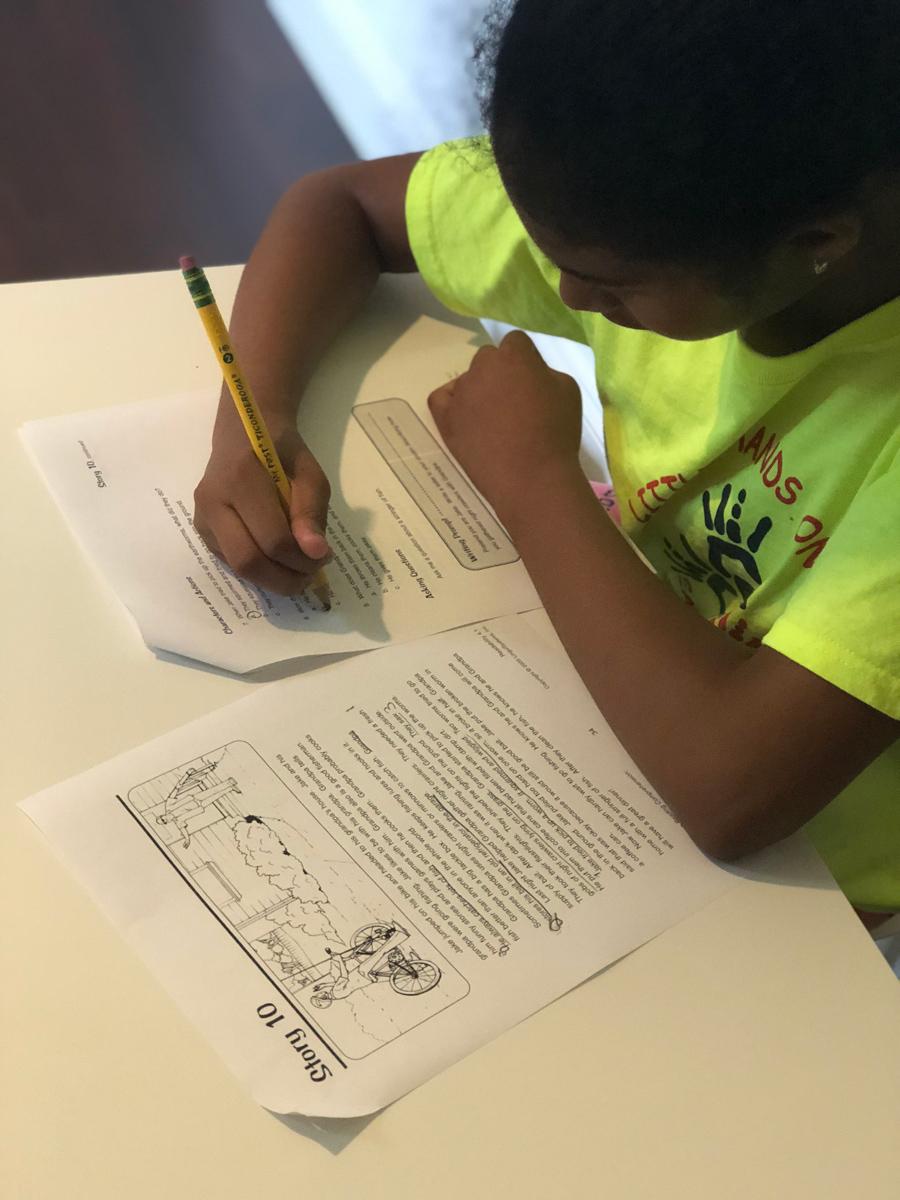 A child working on a speech assignment.